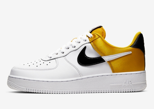 The Nike Air Force 1 Low NBA Adds Golden Yellow Satin