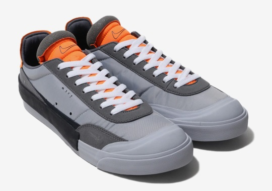 Nike's Drop Type LX Appears In Wolf Grey And Orange