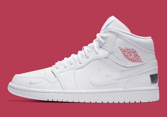 """The Air Jordan 1 Mid """"Nike Swoosh On Tour"""" Dials Up The Amps Through Its Logo"""