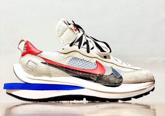 The sacai x Nike Vapor Waffle Emerges In Royal And Red Accents