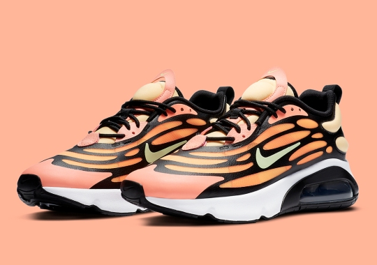 The Nike Air Max 200 Features An Anatomical Web Above A Bright Orange Shell