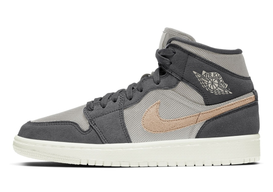 The Air Jordan 1 Mid Applies Light Tan Swooshes To A Grey-Dressed Women's Exclusive