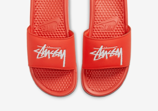 The Stussy x Nike Benassi Slides Drops On July 30th