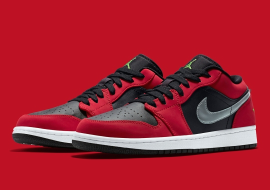 The Air Jordan 1 Low Pairs Bred-Style Uppers With Metallic Swooshes