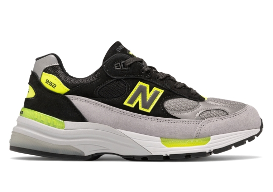 The New Balance 992 Pairs Black And Gray Uppers With Bright Volt Accents