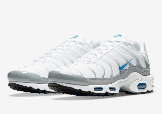 The Nike Air Max Plus Pairs Laser Blue Accents With A Clean White And Silver