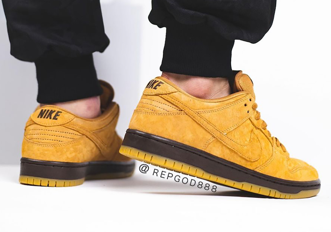 Nike SB Dunk Low wheat shade on foot rear view