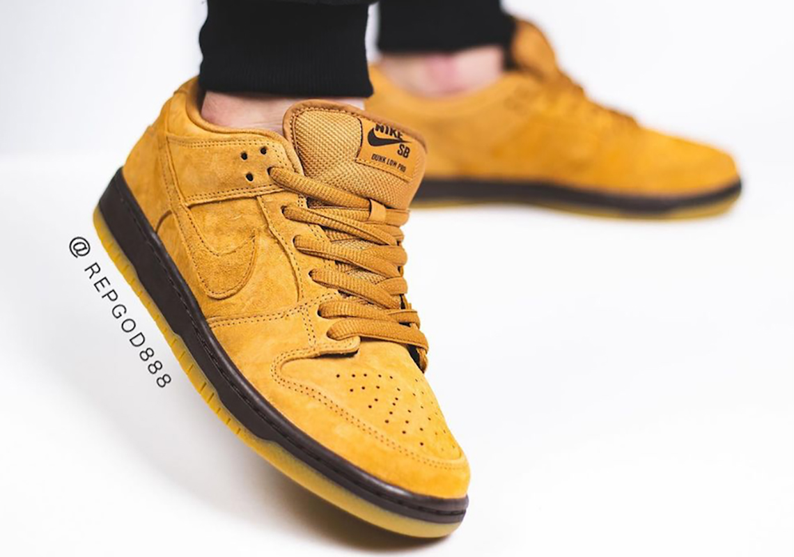 Nike SB Dunk Low wheat shade on foot , focused on left foot