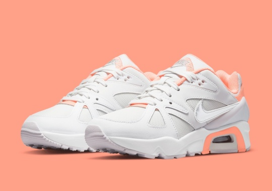 A Nike Air Structure Triax '91 For Kids Appears In White/Coral