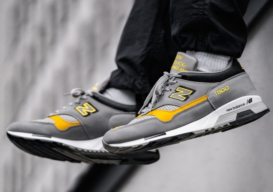 The New Balance 1500 Pairs A Solid Grey With Speed Yellow Accents