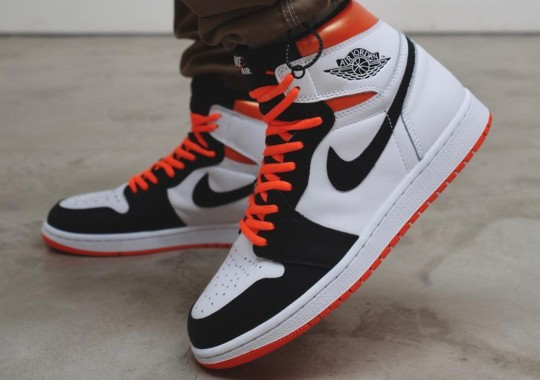 """Starfish"" Orange Takes A Break As The Air Jordan 1 Welcomes ""Electro Orange"""