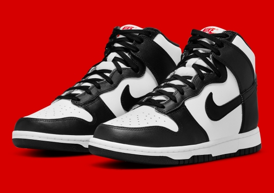 The Nike Dunk High Appears In Black And White With Red Logos