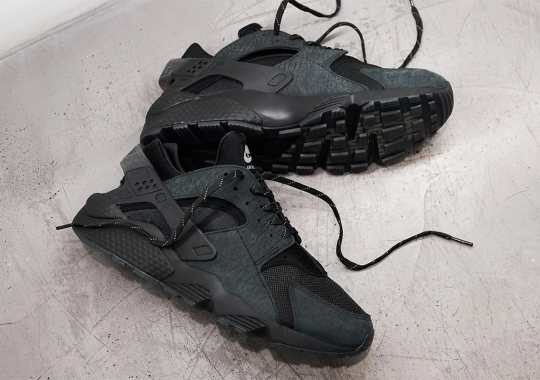 The Original Nike Air Huarache Slogan Featured On This Black Tumbled Leather Drop