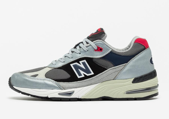 The New Balance 991 Offers A Simple Mix Of Silver, Black, And Blue