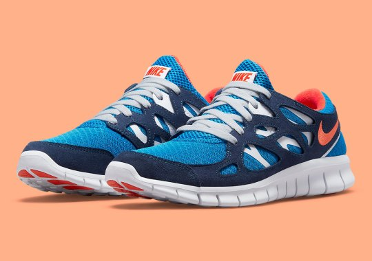 A Sporty Blue And Orange Appear On The Nike Free Run 2 Retro