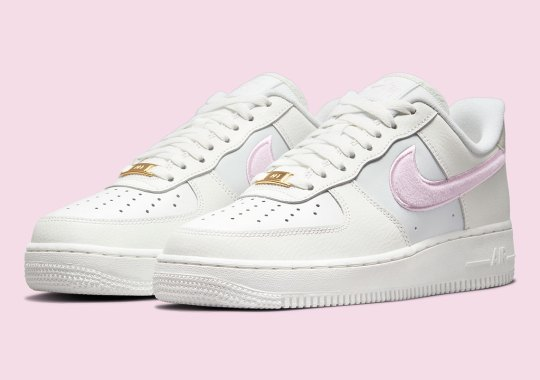 This Women's Nike Air Force 1 Low Features Plush Pink Swooshes