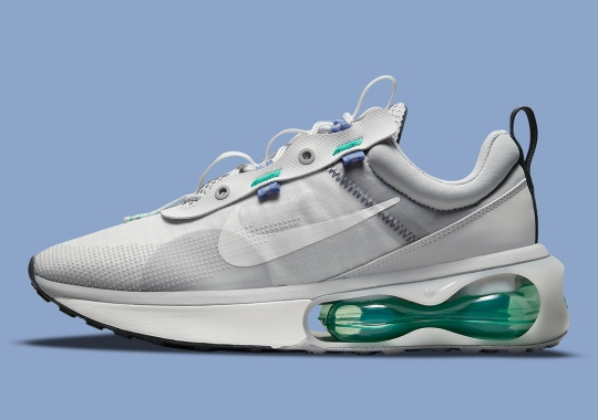 Green And Blue Accents Jump Off This Grey-Dominant Nike Air Max 2021
