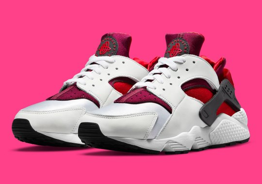 A Splash Of Berry Tones Appears On A Women's Nike Air Huarache