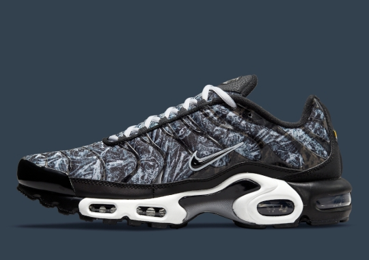A Wild Camouflage Pattern Covers This Black And White Nike Air Max Plus