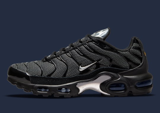 Grid Patterns And Reflective Accents Appear On The Nike Air Max Plus