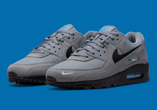 A Hint Of Blue Splashes Onto A Grey Nike Air Max 90