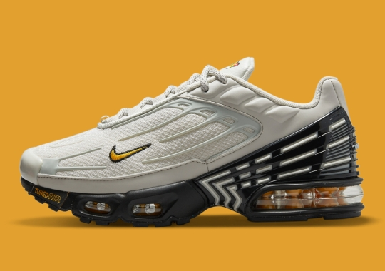 A Kid's Nike Air Max Plus 3 Appears In Grey, Black And Gold